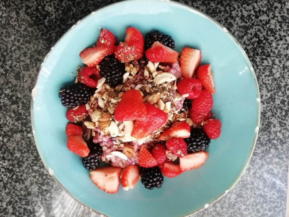 A healthy vegetarian breakfast: porridge with fruit and nuts.
