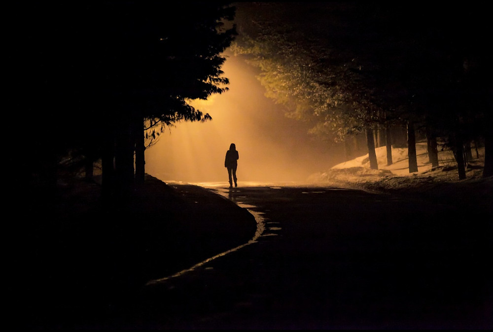 person walking down a secluded road