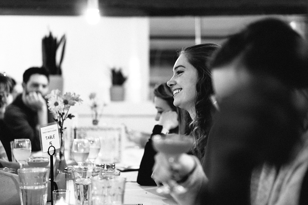 Guest smiling across the table