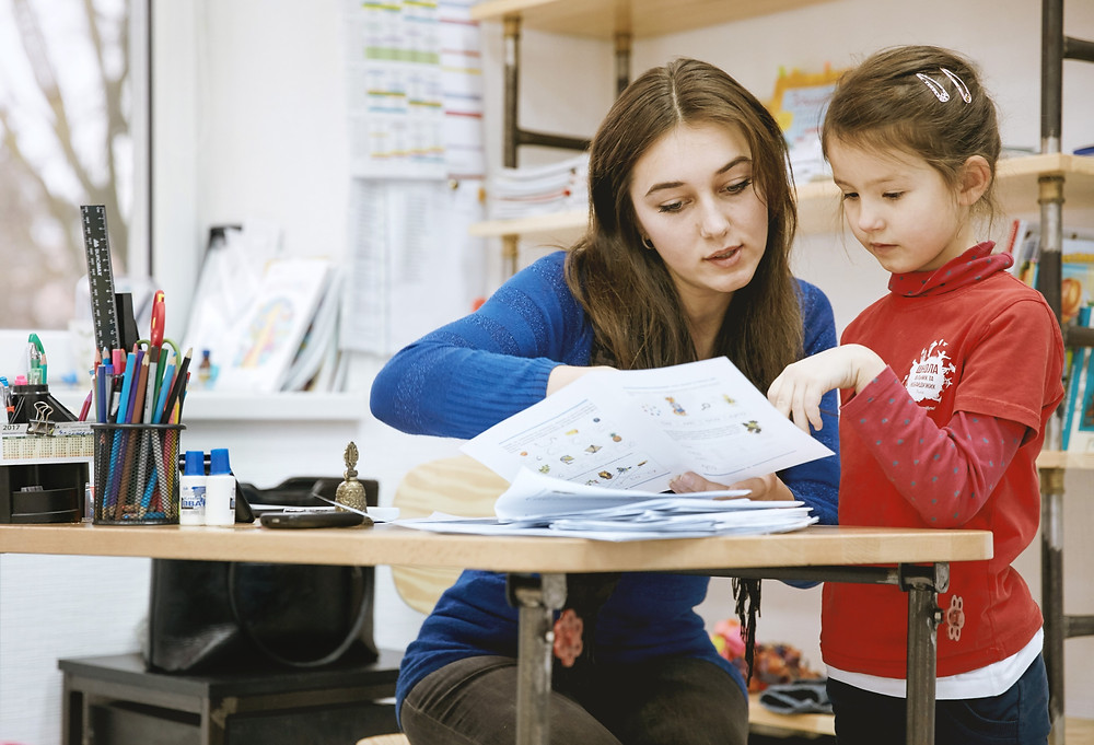 Teenage girl in education childcare T Level placement with employer