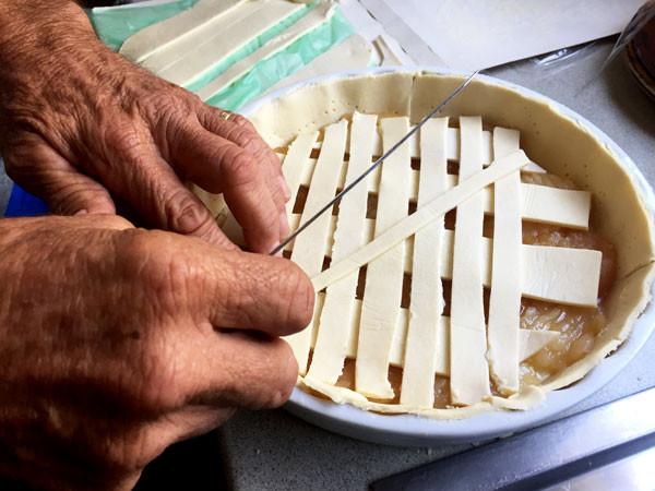 Bob putting a lattice lid on his pie