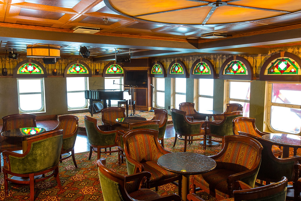 Classic steamship look of the Paddlewheel Lounge on board the American Empress, American Queen Steamboat Company