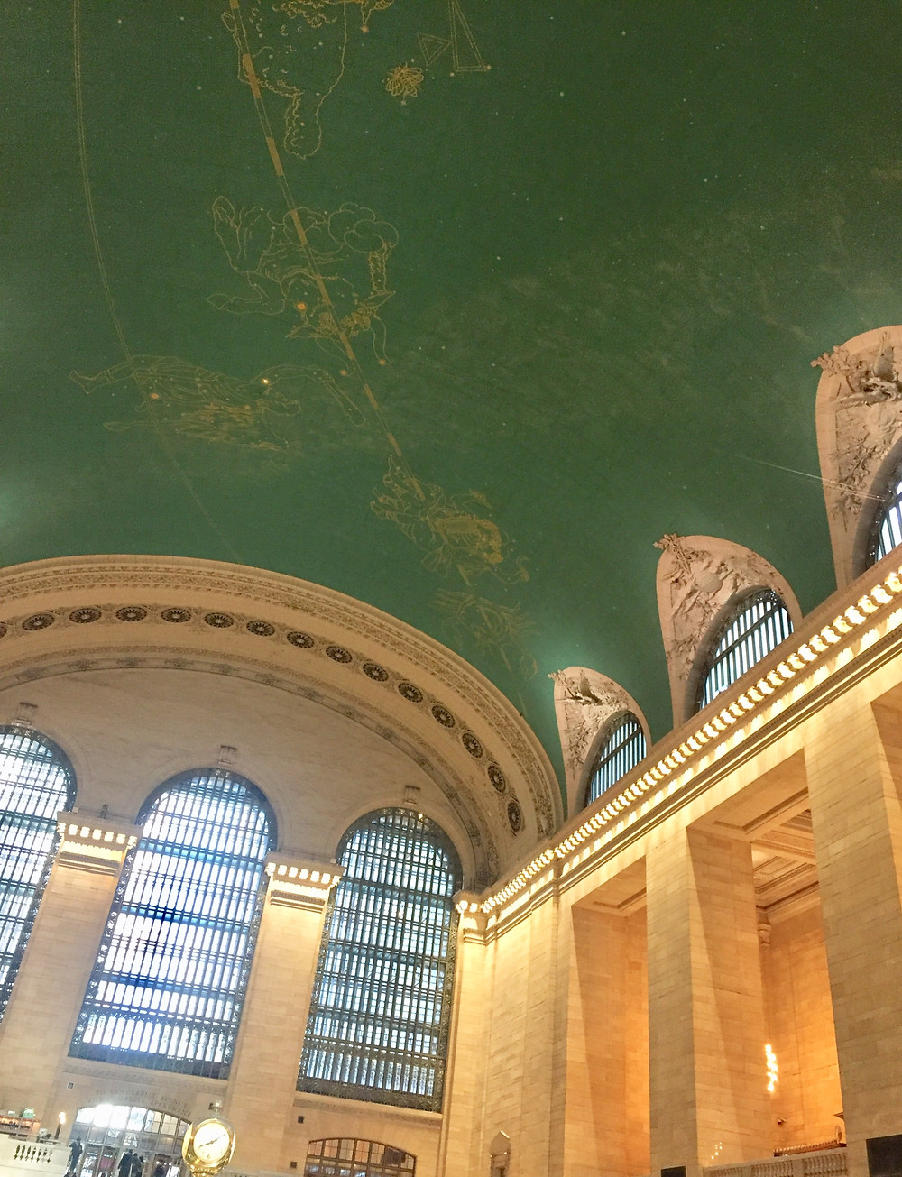The ceiling of Grand Central Station displays the astrology signs defined in gold.