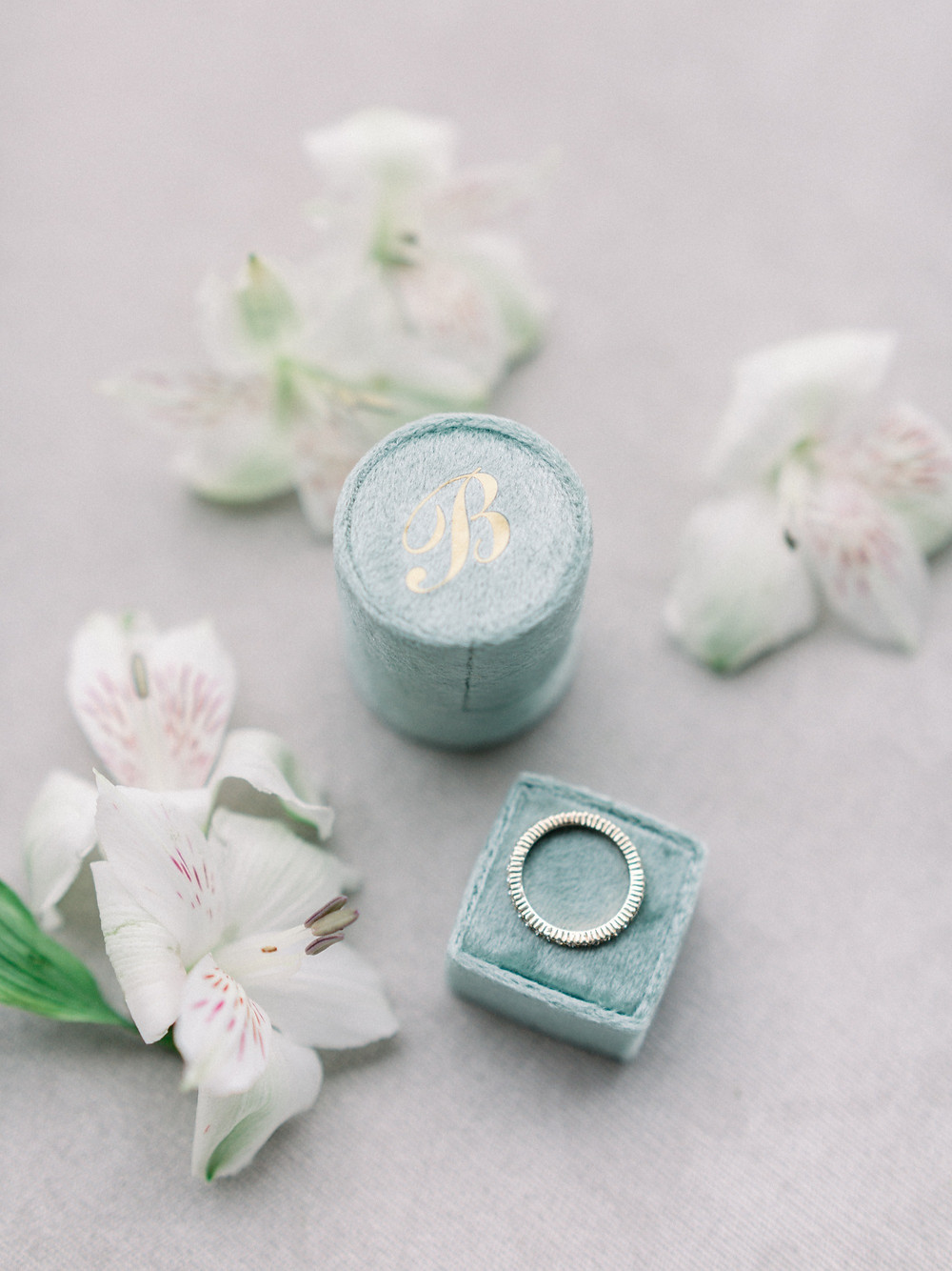 Light green velvet ring box.