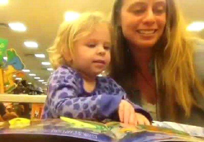 A mother and toddler reading together