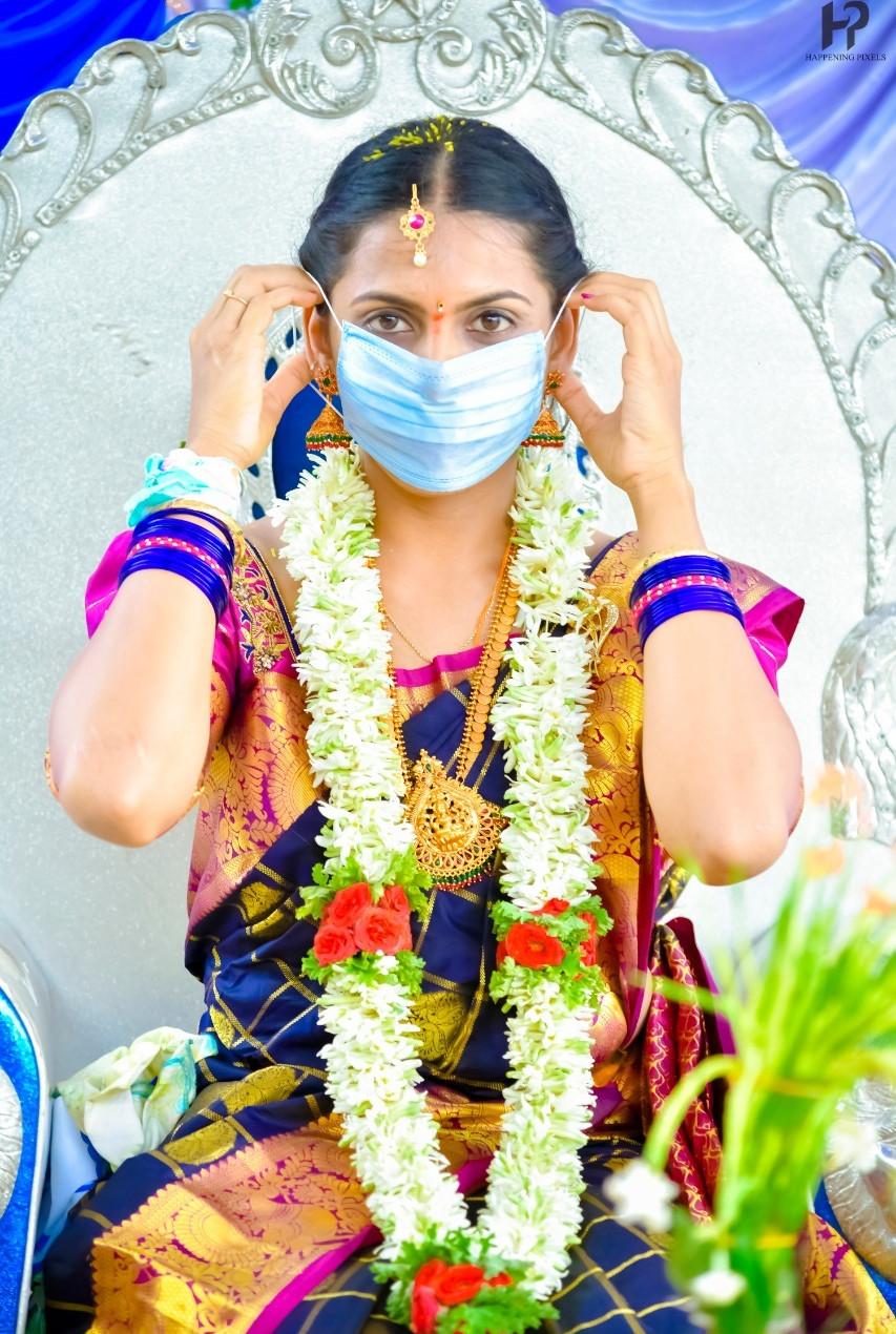 indian wedding bride with mask