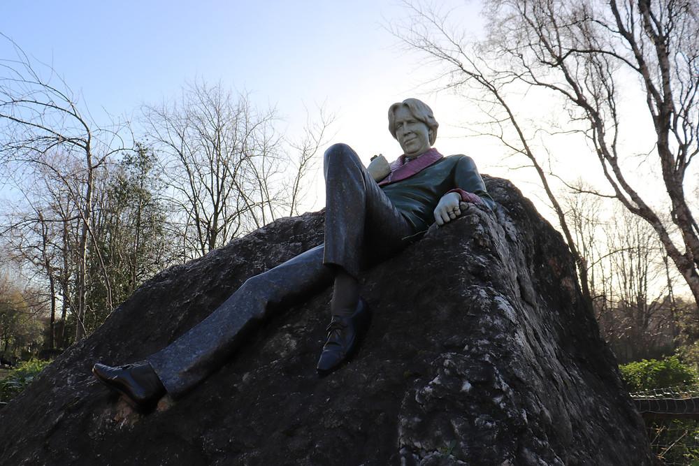 Statue of Oscar Wilde in a park in Dublin Ireland