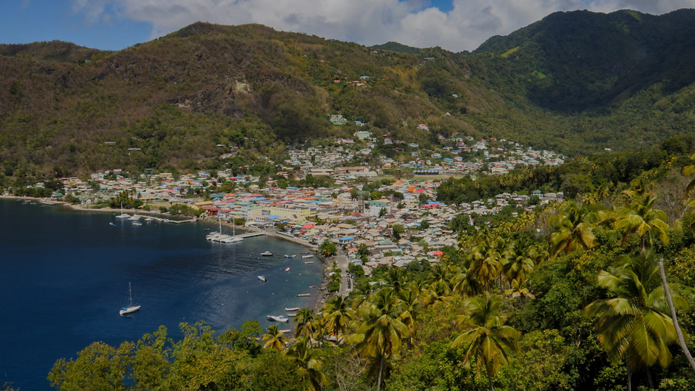 Colourful roof tops and lush green tropical forests of Saint Lucia's Castries beachfront