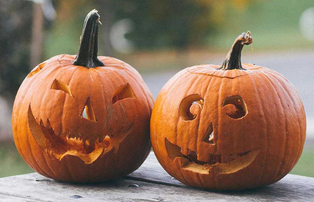Two pumpkins carved for Halloween