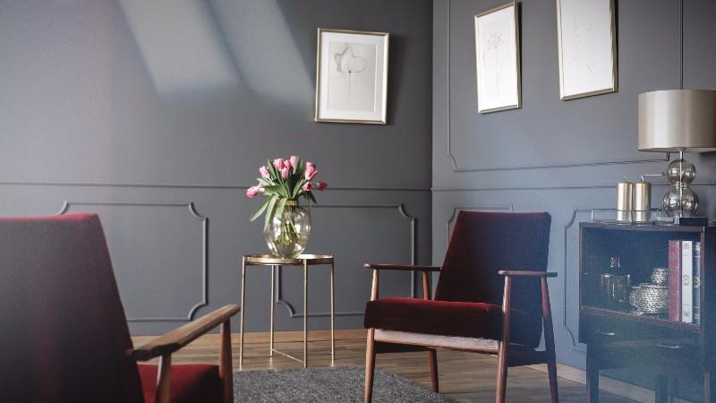 Reforma de oficinas  con una sala de espera con sillones de vintage y decoración elegante