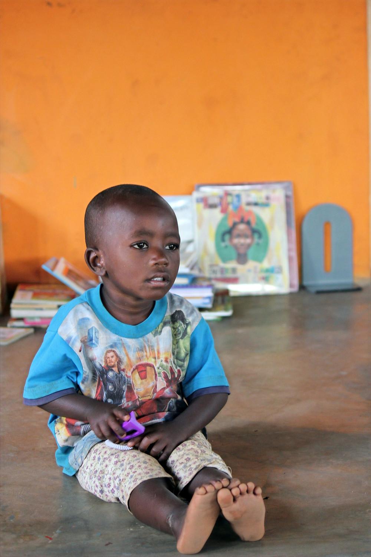 young Busubi boy watching class activities