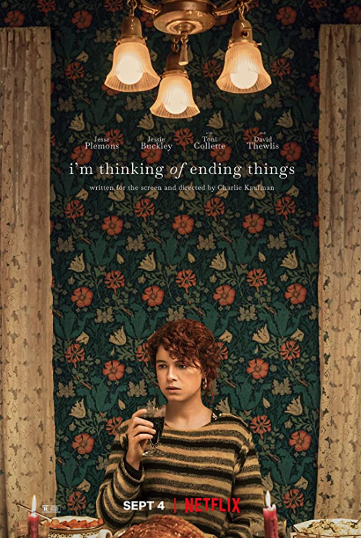 I'm Thinking of Ending Things Movie Poster featuring a woman holding a glass of wine looking confused.