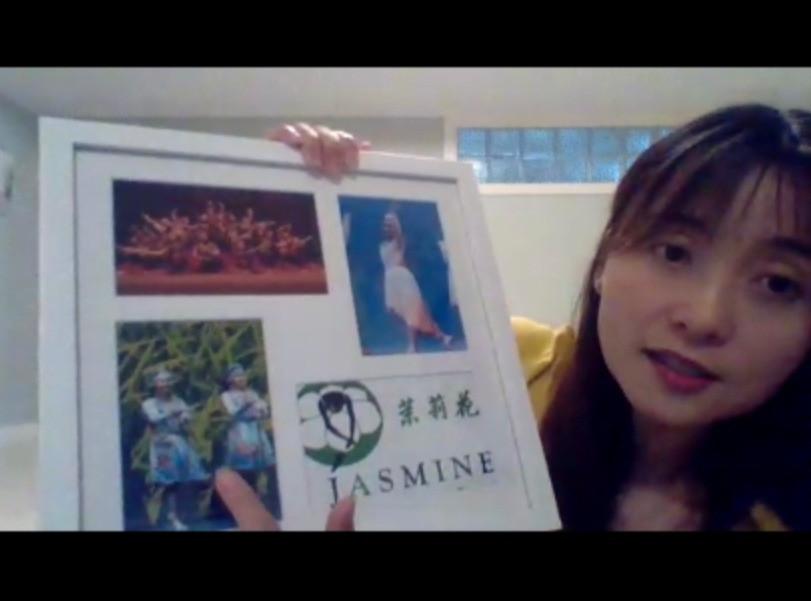 Executive Director Ella Shan displays a senior gift.