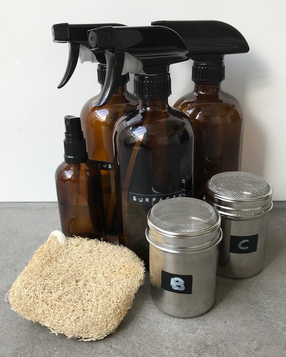 natural cleaning products amber spray bottle