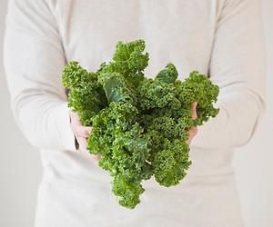 woman holding kale