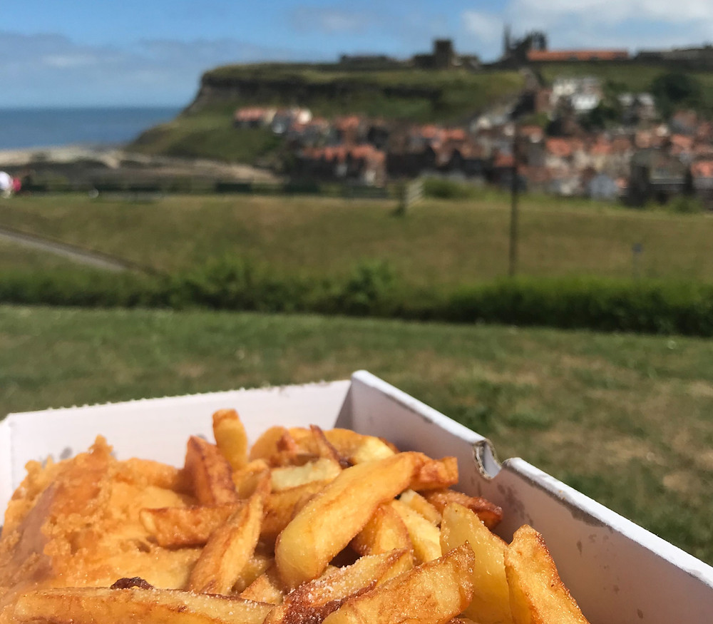 Fish and chips on a hill facing Whitby Abbey in England