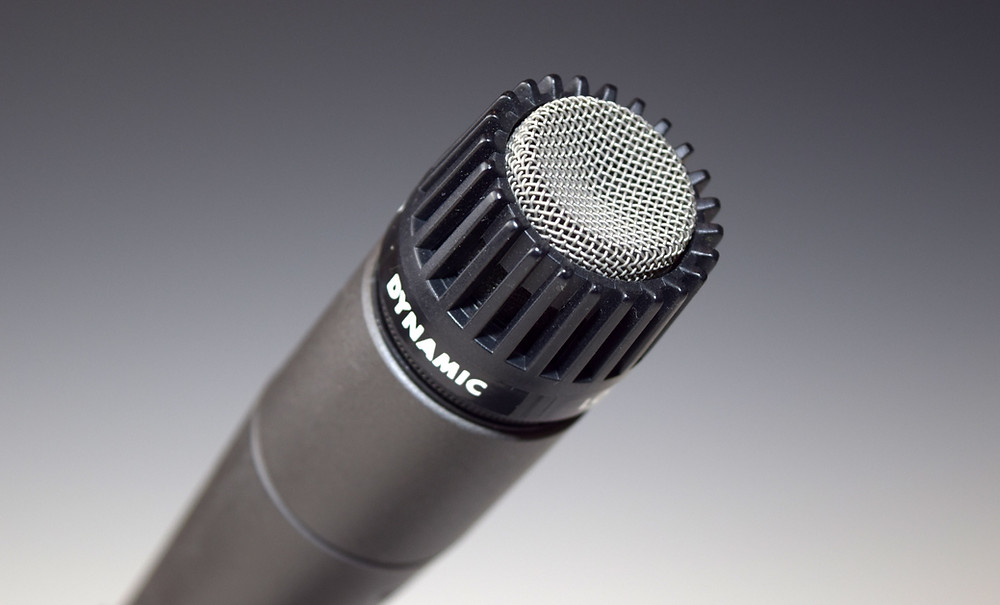 A close-up picture of a Shure SM57 microphone grille