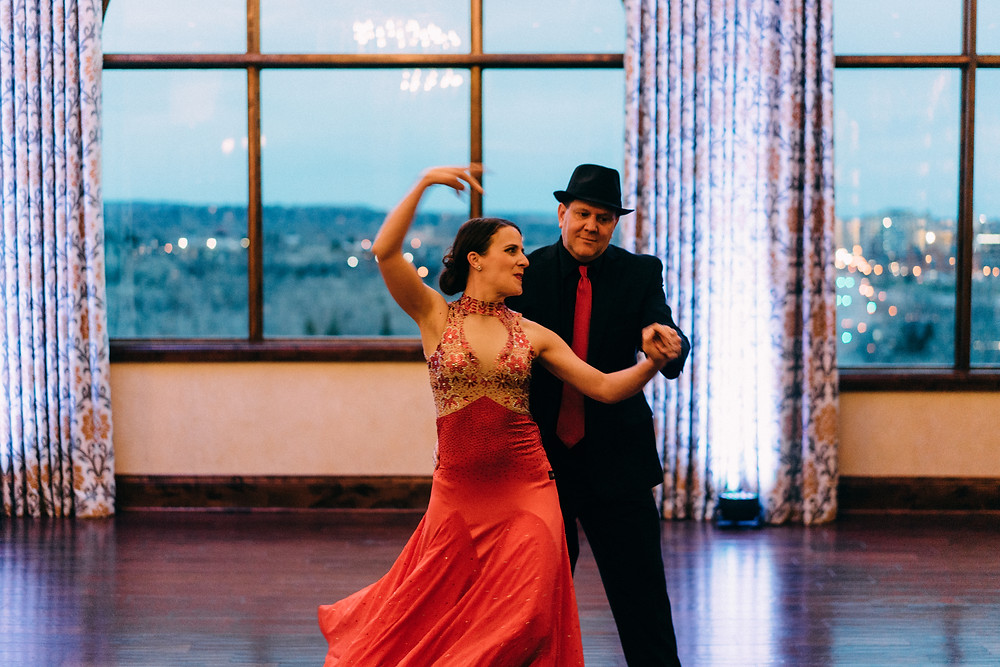Couple dancing a showcase at dusk