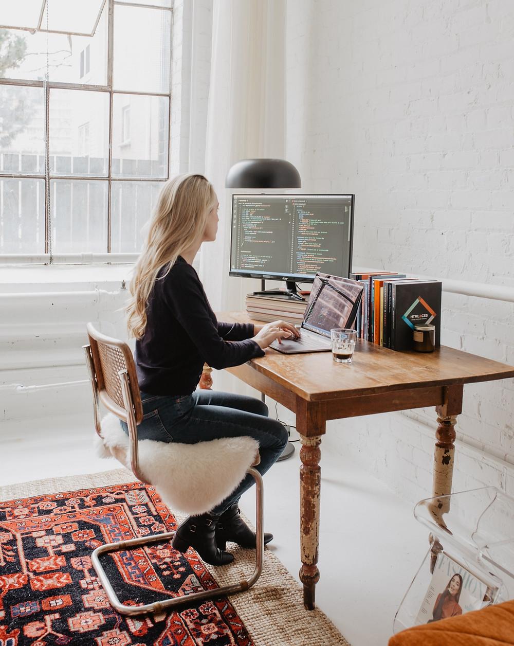 Tiff sat at her desk coding.