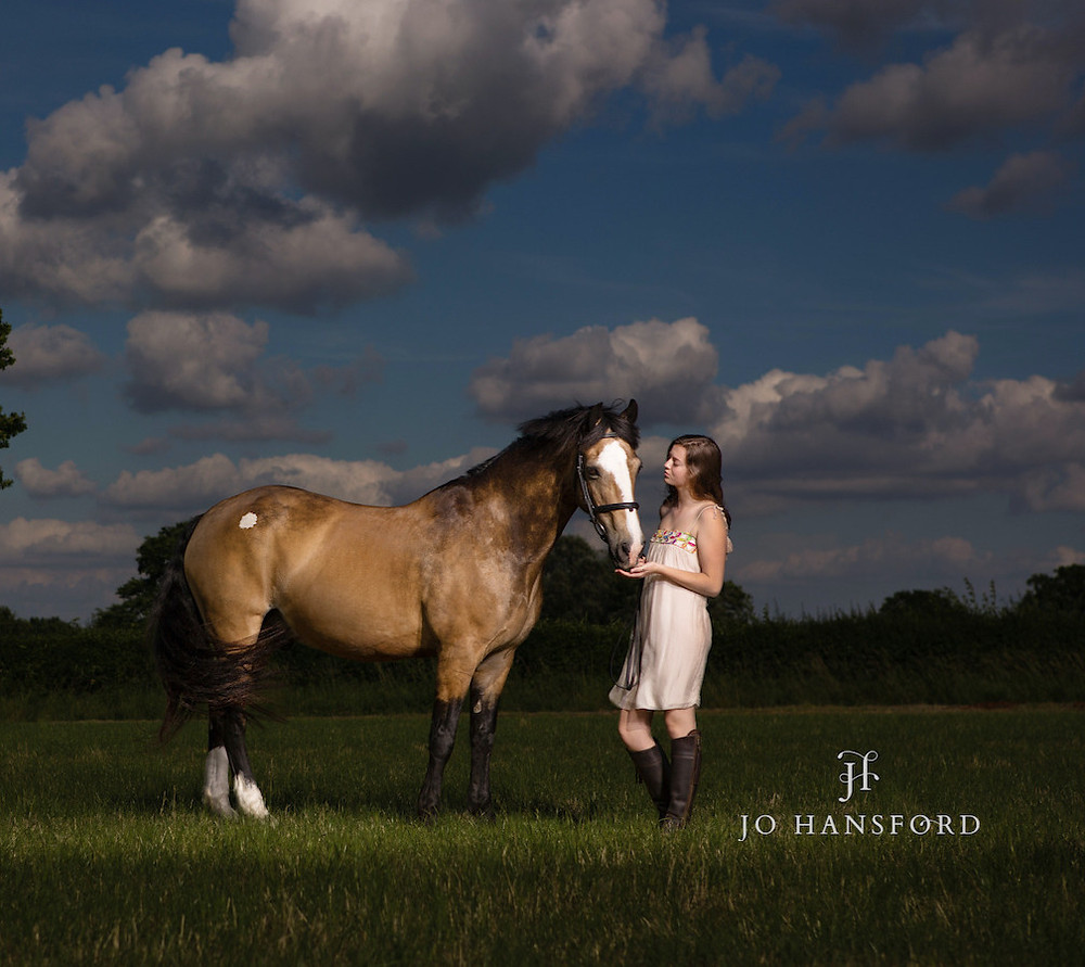 Young girl and her horse sunset photo in field by Jo Hansford Photography