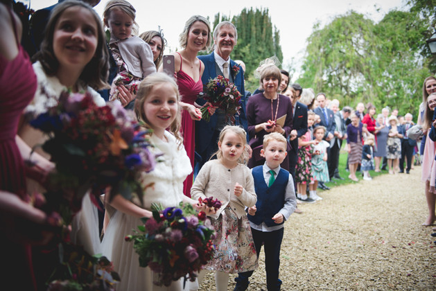 Guests waiting outside Dumbleton Hall Church, ready to throw confetti