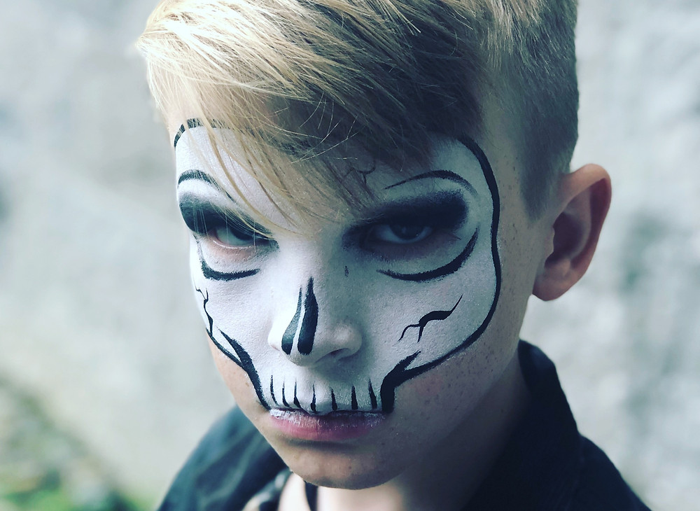 Little boy with skeleton makeup on his face