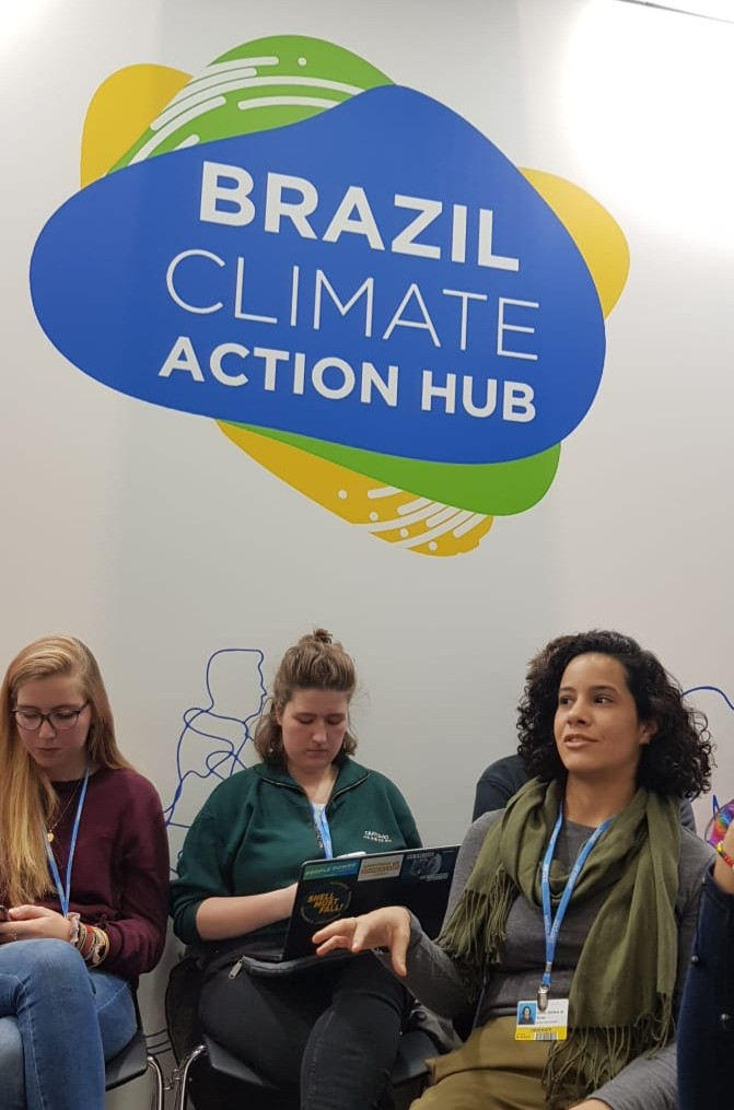 Denize speaking during at the Brazil Climate Action Hub