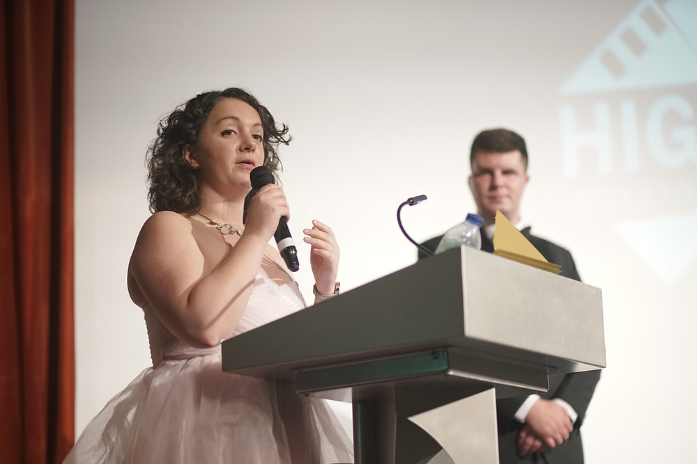 Festival Director Nicole Pott stands at a podium whilst talking at the High Peak Independent Film Festival