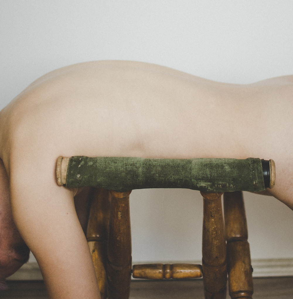 naked man on stool