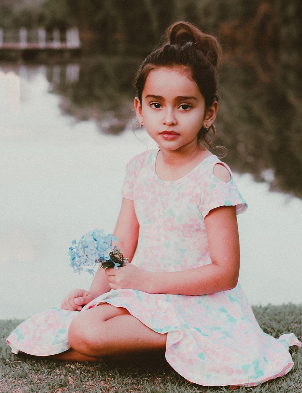 child model posing with flowers, unhappy face.