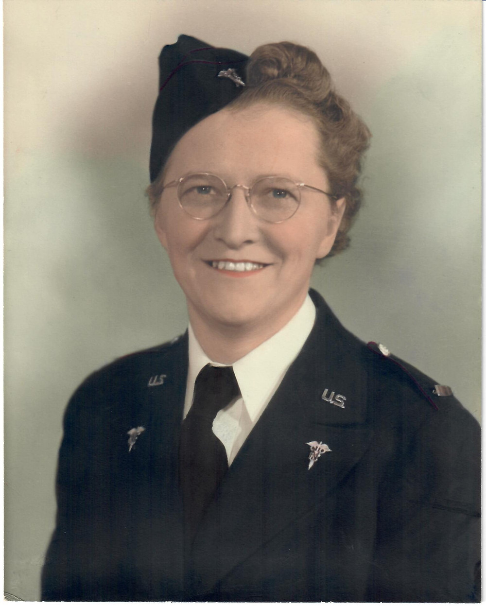 Colorized photo of a WWII 1st Lieutenant Nurse in the U.S. Navy wearing her dress uniform.