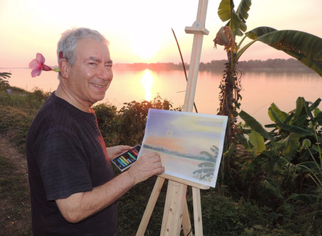Artist with flower painting on the banks of the Mekong River
