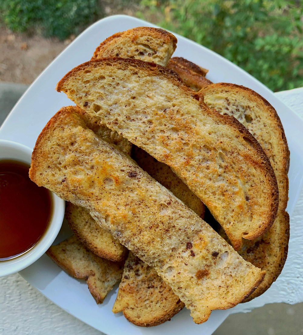 stacked french toast sticks with side of maple syrup in ramekin