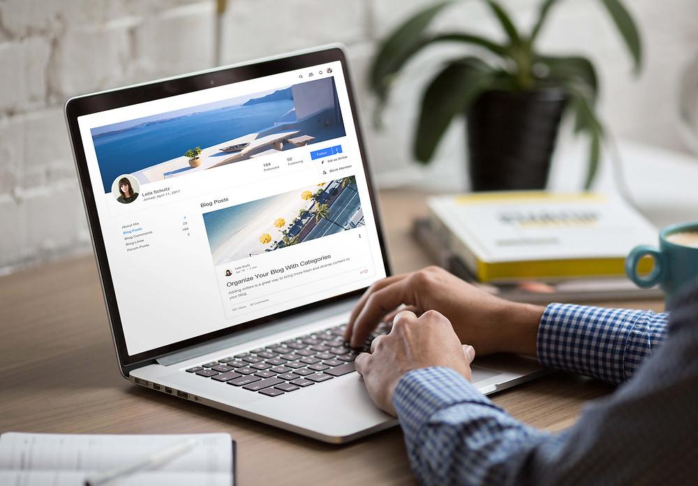 Man reading blogs on his laptop