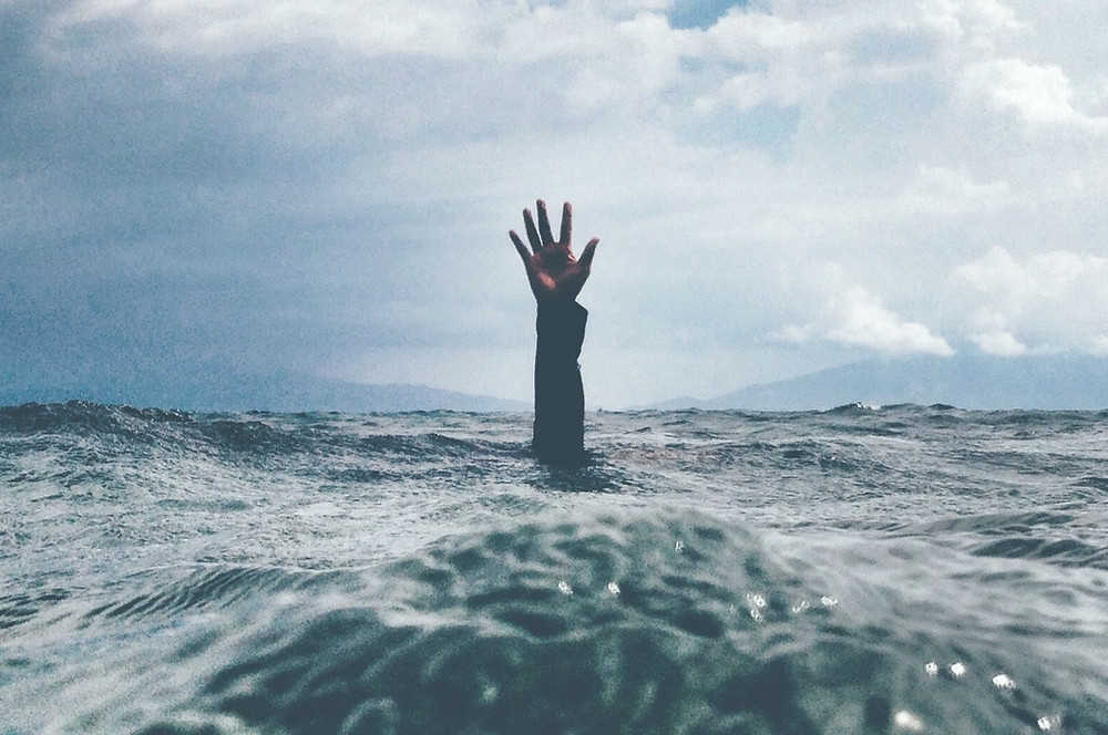 hand-reaching-from-stormy-ocean