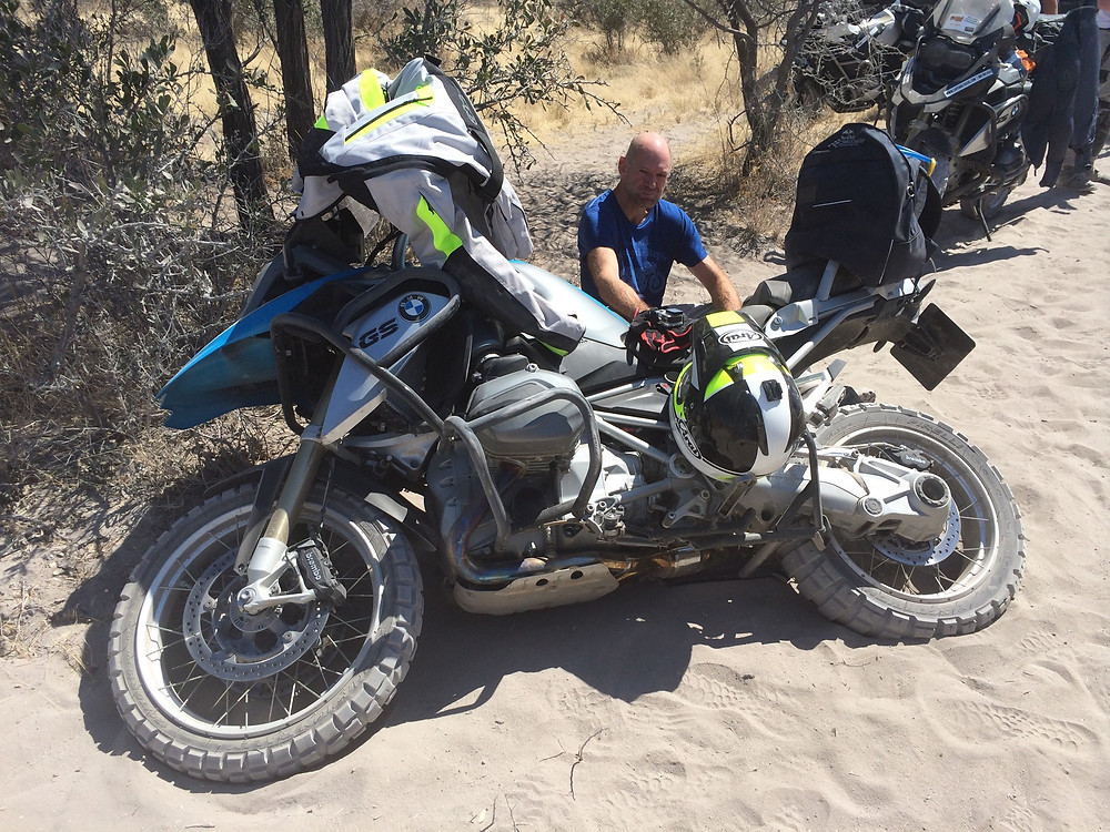 Adrian Newey rides motorcycle