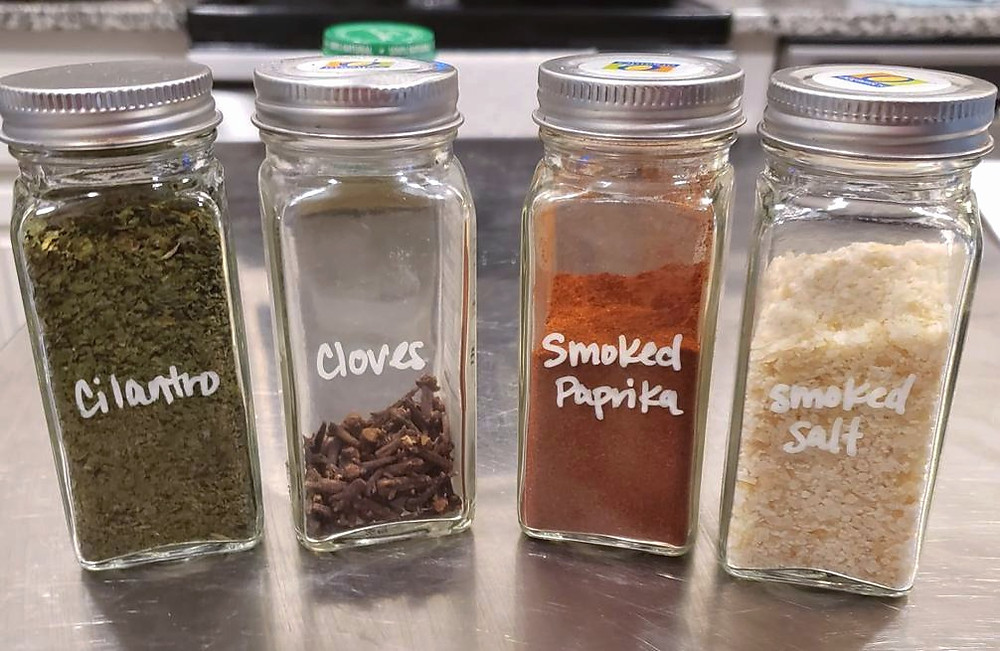 Organize spices in matching containers with chalk marker labels