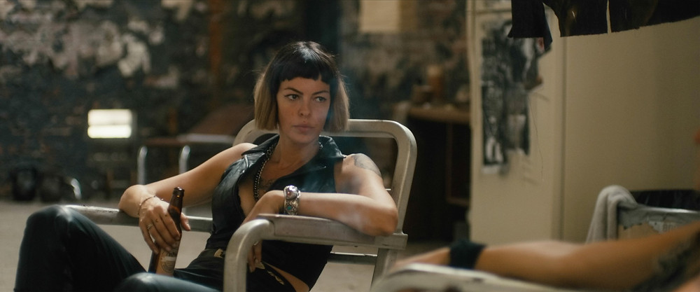 A still from Revenge Ride showing actress Pollyanna MacIntosh relaxing in a chair