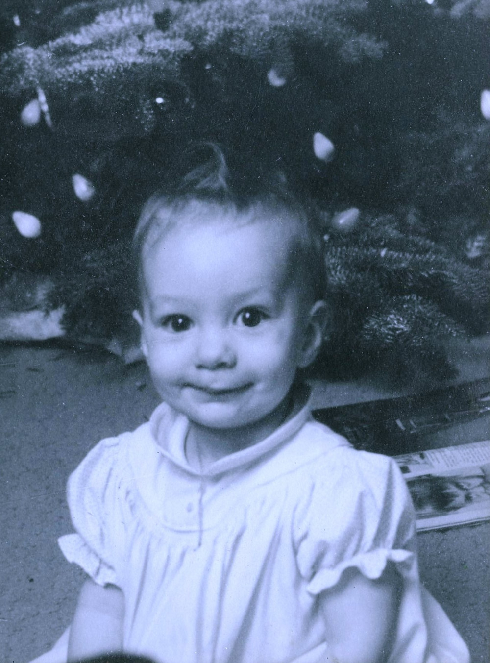 Marie Gettel-Gilmartin in front of Christmas tree