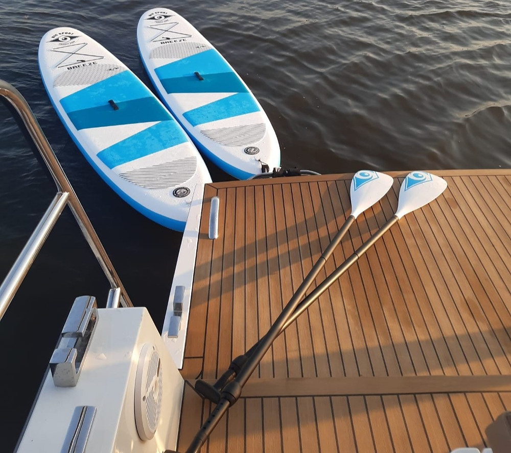 Rent a stand up paddle board with your boating holiday
