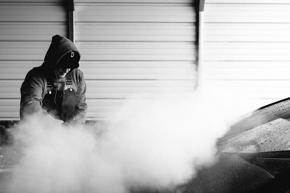 Drift employee steam cleaning a customer's car