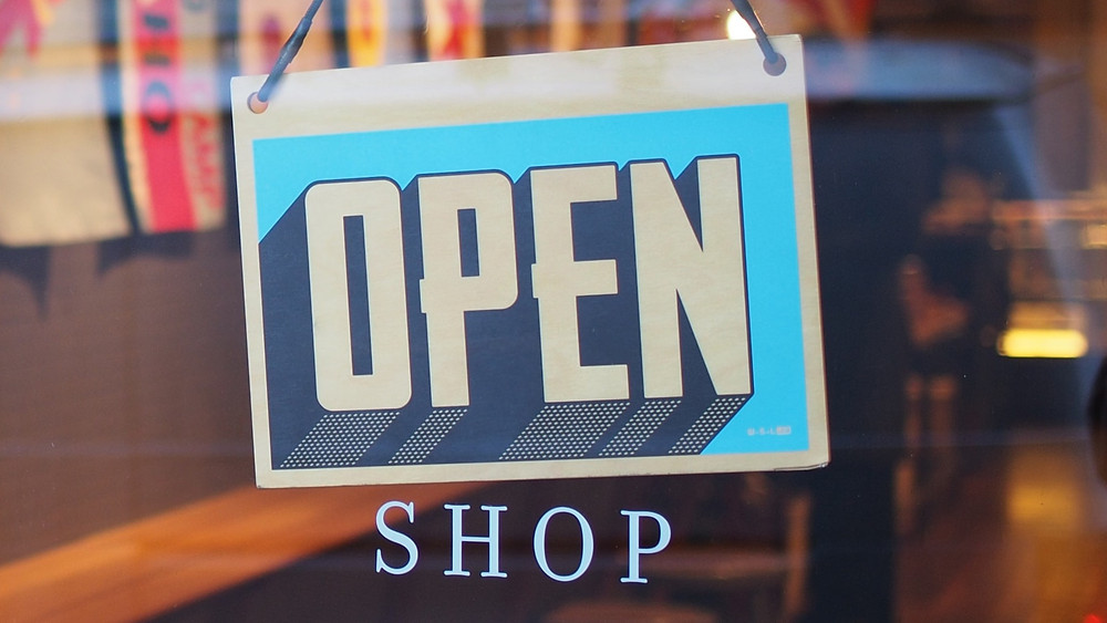 'Open' shop sign at a shop window