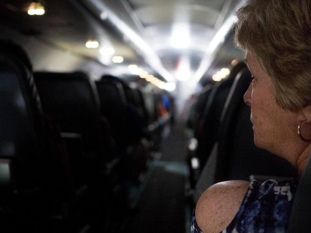 Woman looking across the aisle on a plane