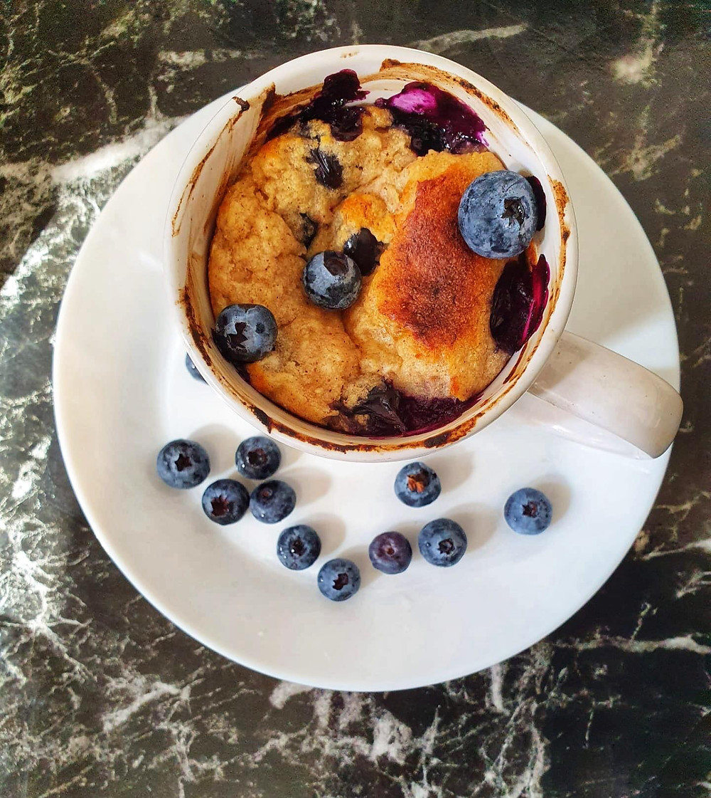 Aerial view of a healthy blueberry cookie mug