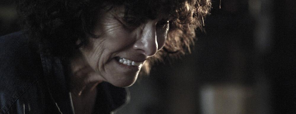 A film still showing Adrienne Barbeau in Unearth