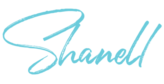 """The word """"Shanell"""", written in a teal script-font."""