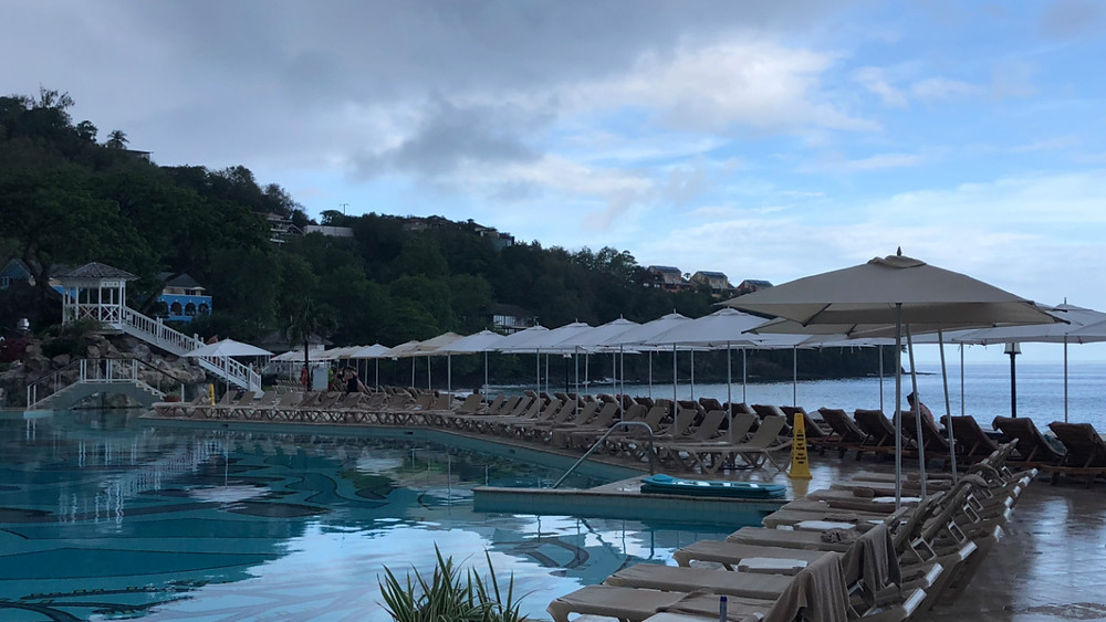 Rain clearing over the pool, destination wedding day at Sandals St Lucia La Toc