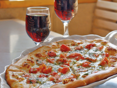 Come in for a slice and a beer or glass of wine after work or class!