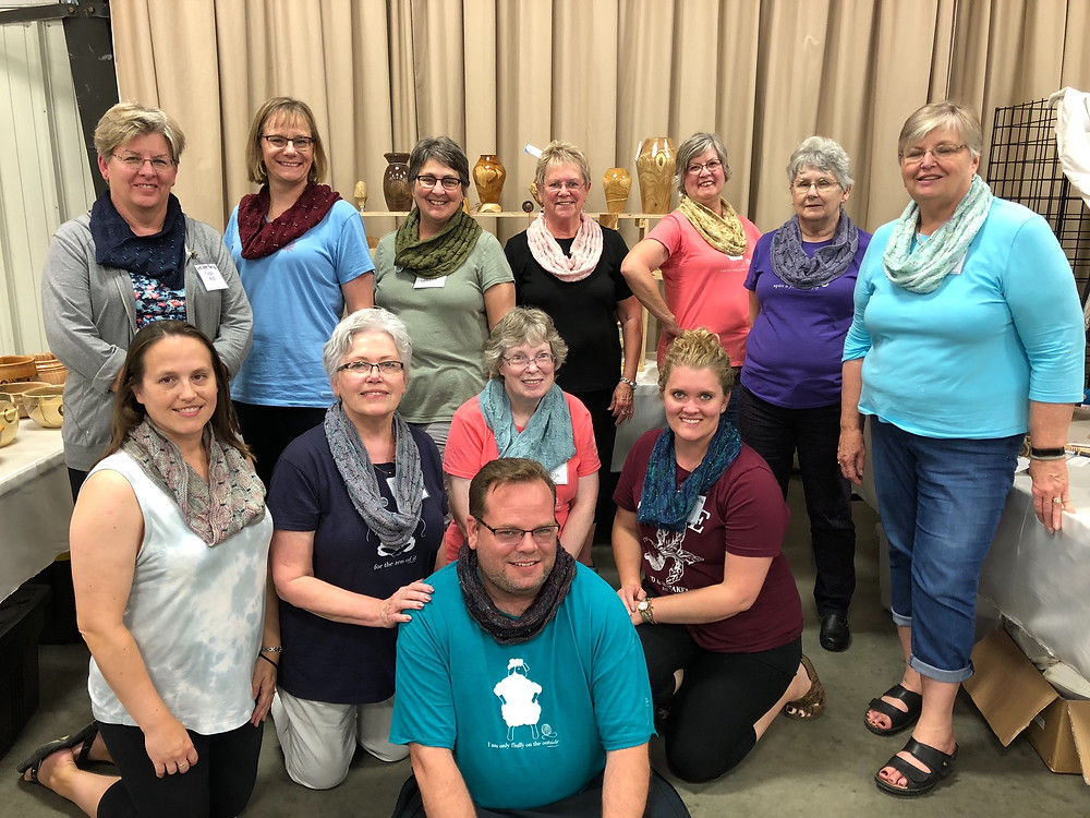 The North Dakota Knitting Group shows off their Soiree Cowls at the Saturday night Fashion Show