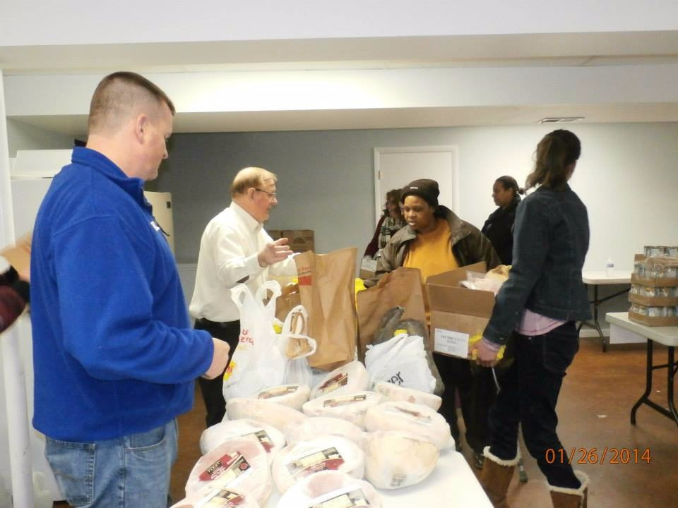 Handing out turkeys at the Bread of life food bank at Strong Tower Church in forest hill maryland.